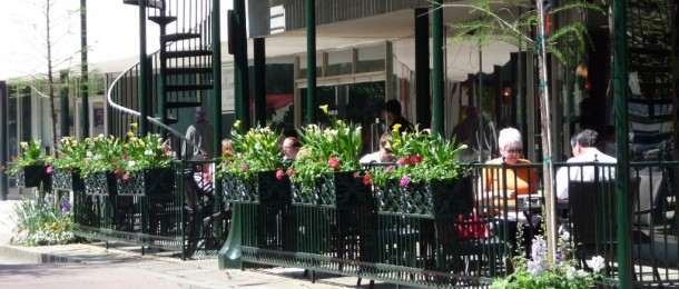 Window boxes on a railing at a cafe