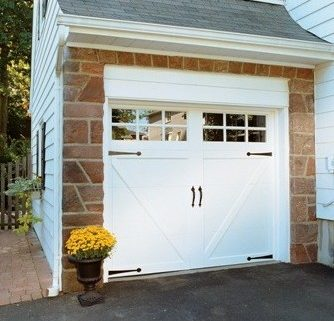 White garage door with decorative hardware