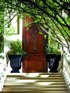 Flank front entrances symmetrically with vinyl planters for a curb appeal knockout!