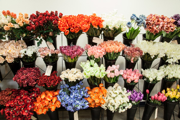 A bountiful offering in your floral showroom is the way to go - showcase your selection of silk sprays in an organized manner.