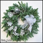 Glittering with fresh 'snow' this live pine wreath welcomes everyone warmly.