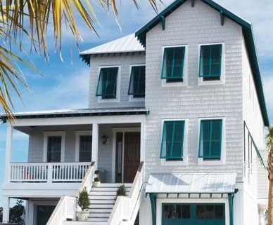A white house with Bahama shutters