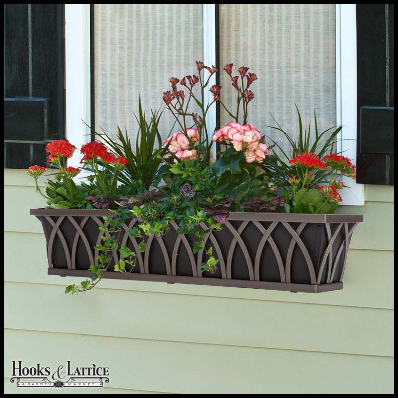 See how the color pops? The flowers are bright, and the window box (Arch Decora Shown) is an architectural element all on its own!