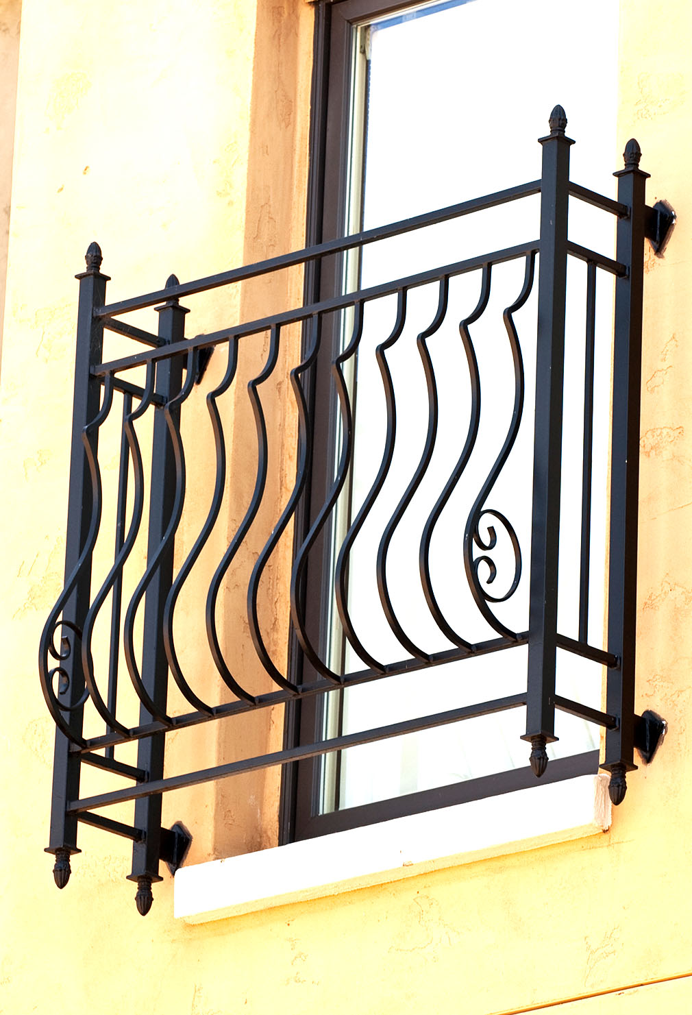 Finishing touches like finials and hand bent wrought iron scrollwork give your home a custom look