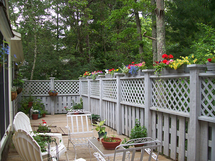 Jan's scalloped wood window boxes make a big impact on her deck.