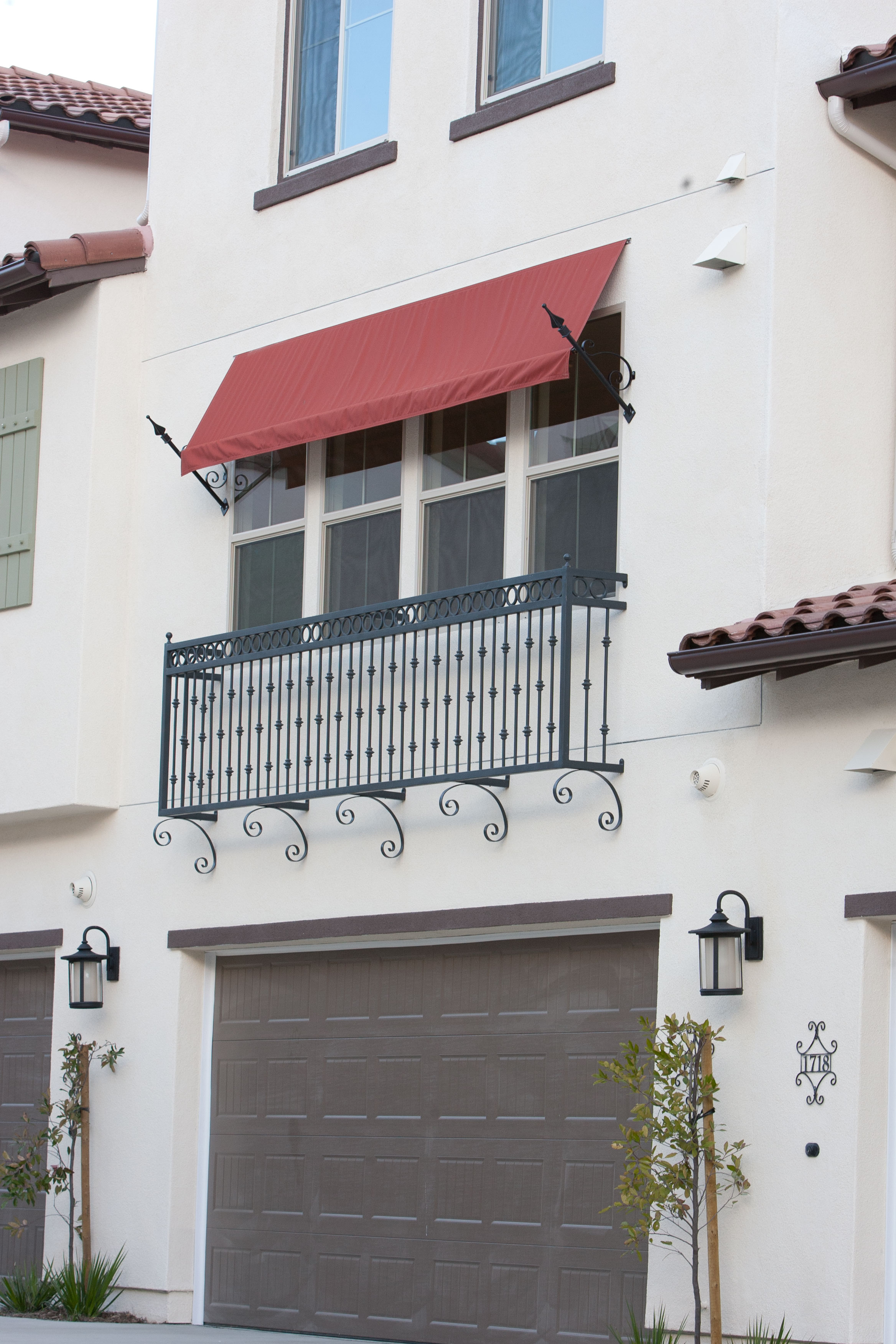 A faux balcony adds unique curb appeal to otherwise boring windows